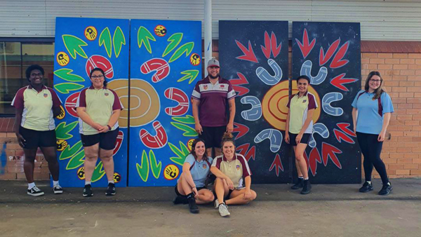 Students from Rutherford High in front of mural created for Mental Health Month